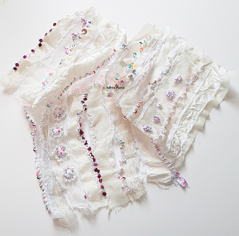 A veil like piece of cloth with embroidered silks and sequins.