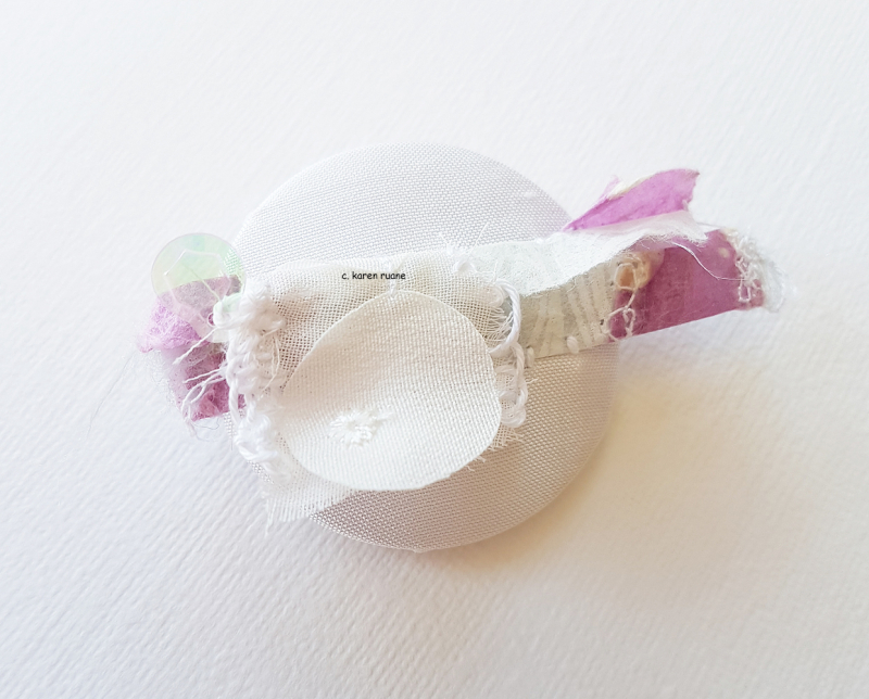 Rolled embellishment button 4